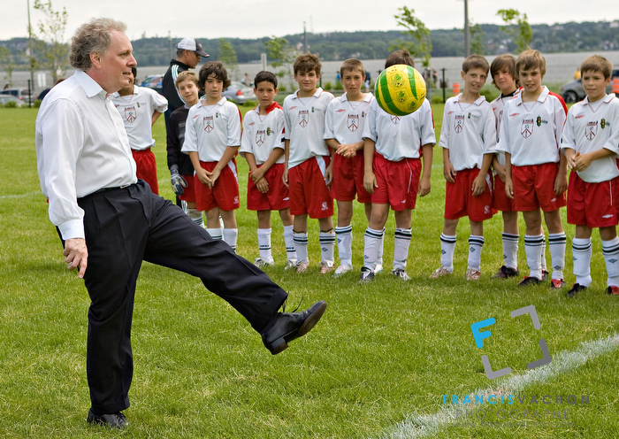 Quebec Premier Jean Charest kicks a ball as he inaugurates a soccer field, part of the Promenade Samuel-de-Champlain Tuesday June 24, 2008 in Quebec City. The Promenade, a 2.5km parkway along the St-Lawrence River, is the gift from the government of Quebec to Quebec city for her 400th's birthday (Photo Francis Vachon)
