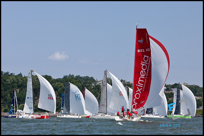 Sail boat Proximedia, with the red sail, joins a pack of boat