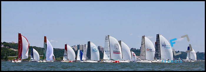 A tight pack of sail boats