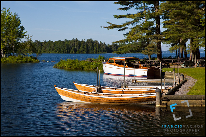 Wooden boats docked on Sebago Lake