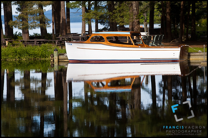 Wooden boat docked on Sebago Lake