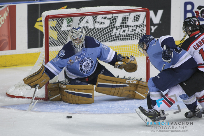 Rimouski Oceanic goal keeper Louis-Philip Guindo eyes the puck in first period action at the Memorial cup tiebreaker at Le Colisee Pepsi in Quebec city Thursday May 28, 2015.