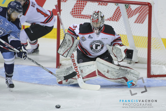 Quebec Remparts goal keeper Zachary Fucale eyes the puck in first period action at the Memorial cup tiebreaker at Le Colisee Pepsi in Quebec city Thursday May 28, 2015.