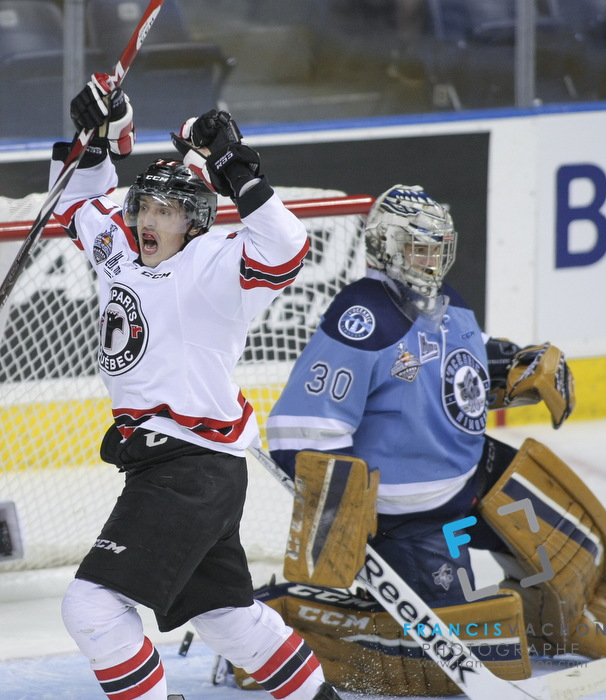 Quebec Remparts forward Jerome Verrier celebrates his goal as Rimouski Oceanic goal keeper Louis-Philip Guindo looks down in first period action at the Memorial cup tiebreaker at Le Colisee Pepsi in Quebec city Thursday May 28, 2015.