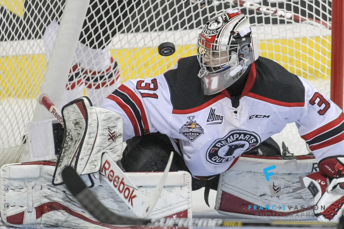 Quebec Remparts goal keeper Zachary Fucale eyes the puck in second period action at the Memorial cup tiebreaker at Le Colisee Pepsi in Quebec city Thursday May 28, 2015.
