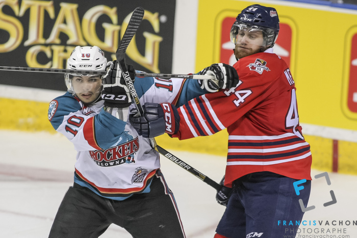 Oshawa Generals' Dakota Mermis breaks his stick as he hits Kelowna Rockets' Nick Merkley during Memorial Cup finals action in Quebec City on Sunday May 31, 2015. Francis Vachon/Postmedia Network