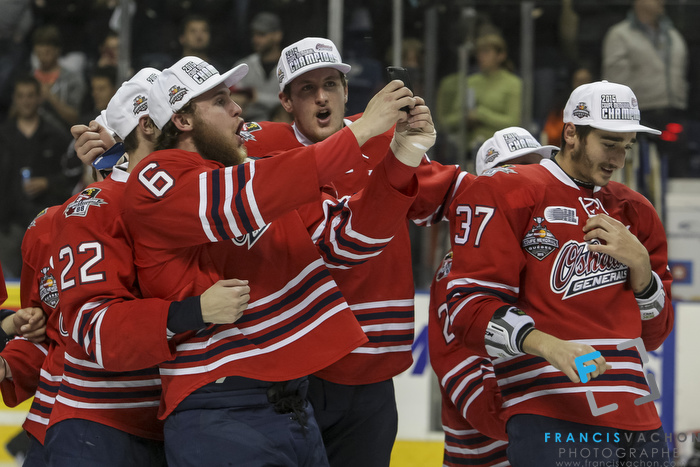 Oshawa Generals Will Petschenig takes a selfie with his teammate after winning the Memorial Cup final in Quebec City  on Sunday May 31, 2015. Francis Vachon/Postmedia Network