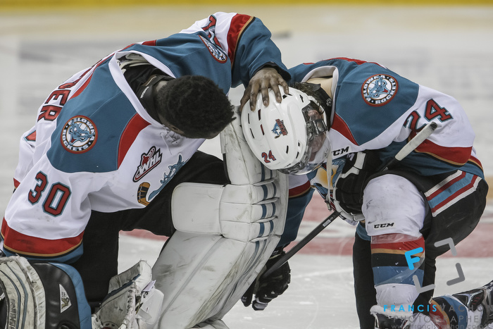 Kelowna Rockets' Michael Herringer puts his hand on his teammate Tyson Baillie after their team lost against the Oshawa Generals in the Memorial Cup final in Quebec City  on Sunday May 31, 2015. Francis Vachon/Postmedia Network
