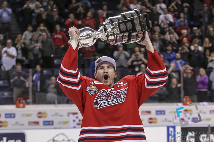 Oshawa Generals captain Josh Brown celebrates with the Memorial Cup after winning the final against the Kelowna Rockets in Quebec City on Sunday May 31, 2015. Francis Vachon/Postmedia Network