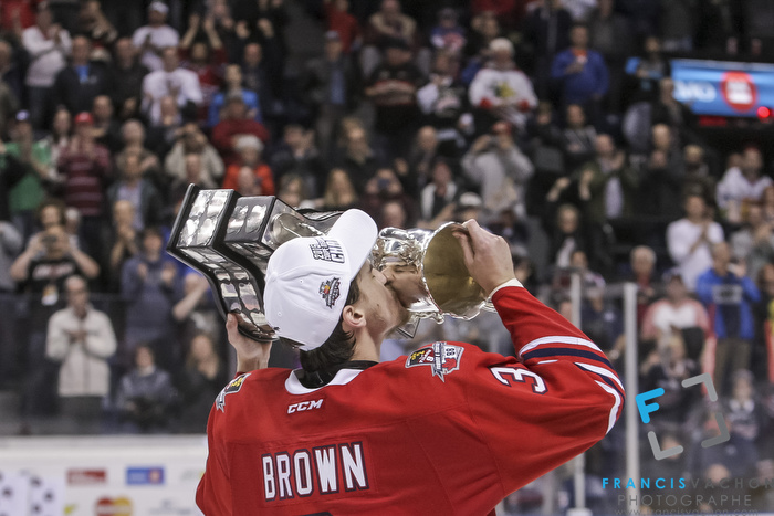 Oshawa Generals captain Josh Brown kisses the Memorial Cup after winning the final against the Kelowna Rockets in Quebec City on Sunday May 31, 2015. Francis Vachon/Postmedia Network