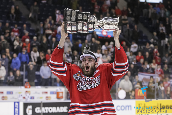 Oshawa Generals' Hunter Smith raises the Memorial Cup after winning the final against the Kelowna Rockets in Quebec City on Sunday May 31, 2015. Francis Vachon/Postmedia Network