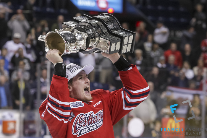 Oshawa Generals' Michael McCarron raises the Memorial Cup after winning the final against the Kelowna Rockets in Quebec City on Sunday May 31, 2015. Francis Vachon/Postmedia Network