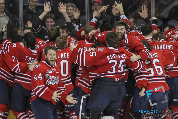 Oshawa Generals' players celebrate the overtime winning goal to win the Memorial Cup against the Kelowna Rockets in Quebec City on Sunday May 31, 2015. Francis Vachon/Postmedia Network