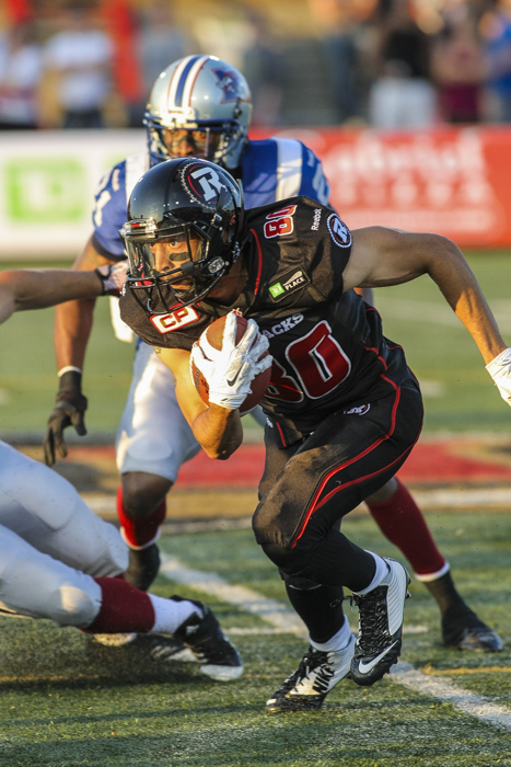 Ottawa Redblacks' Chris Williams runs with the ball during CFL action in Quebec City on Saturday June 13, 2015. Francis Vachon/Postmedia Network