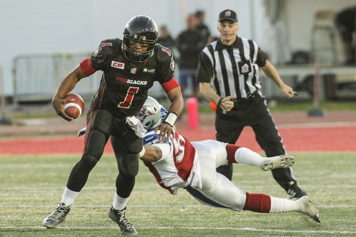 Montreal Alouettes' Chris Bakers tackles Ottawa Redblacks' Henry Burris during CFL action in Quebec City on Saturday June 13, 2015. Francis Vachon/Postmedia Network