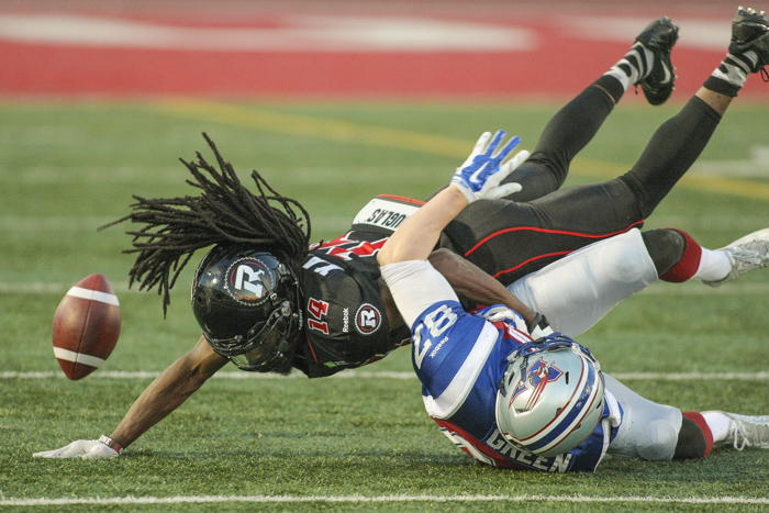 Montreal Alouettes Brandan Green and Ottawa Redblacks' Abdul Kanneh fight for the ball during CFL action in Quebec City on Saturday June 13, 2015. Francis Vachon/Postmedia Network