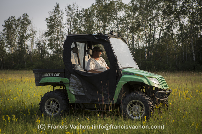 Yves Breton sits in is Arctic Cat prowler 650 H1 as he looks at his horses on his farm in Saint-Laurent, Manitoba, Friday August 14, 2015.